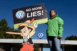 A Greenpeace activist protests in front of Volkswagen in Wolfsburg, Germany on September 25, 2015 (Fabian Bimmer / Reuters)